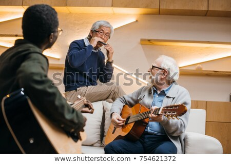 Group of friends singing song together in bar Stock photo © wavebreak_media
