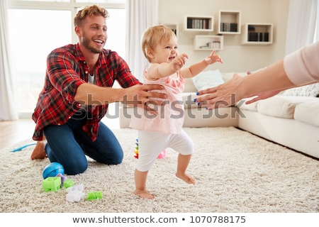 Adult helping baby to walk Stock photo © IS2