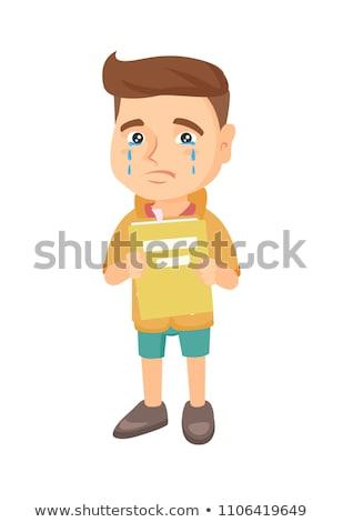 Caucasian upset boy with book shedding tears. Stock photo © RAStudio
