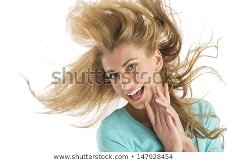 young woman tossing blond hair stock photo © iofoto