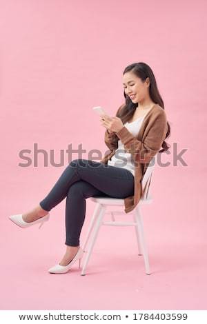 smiling woman sitting on the chair stock photo © acidgrey