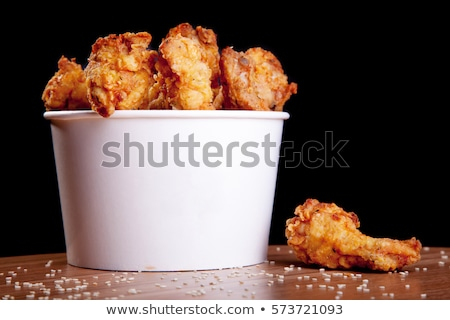 Bucket of chicken wings Stock photo © dash