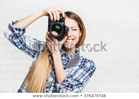woman photographer takes images with dslr camera stock photo © artfotodima