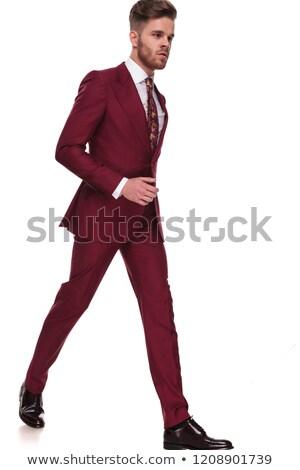 Jeunes gentleman étapes côté regardant vers le bas costume Photo stock © feedough