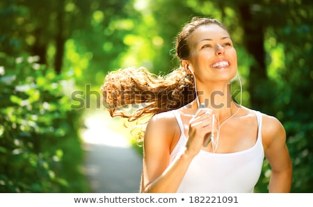 female runner running during outdoor workout in the park stock photo © boggy