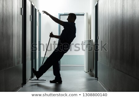 man falling while mopping floor in corridor stock photo © andreypopov