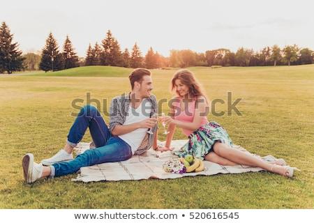 пару цветы питьевой шампанского пикника любви Сток-фото © dolgachov