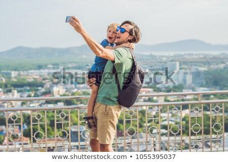 Filho pai alto ver phuket ponto colina Foto stock © galitskaya