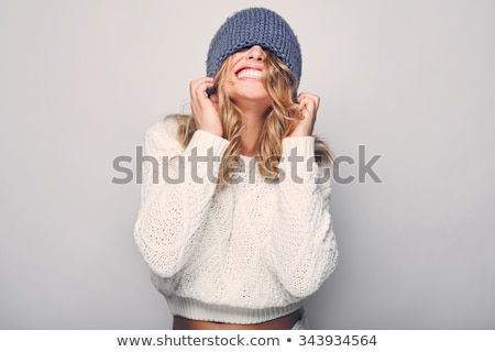 lovely young woman wearing sweater and hat stock photo © deandrobot