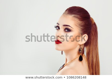 beautiful girl with long ponytail and red lips Stock photo © svetography