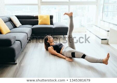 adult woman training abs abdominals doing scissors with legs stock photo © diego_cervo