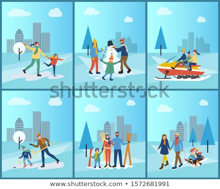 family snowmobiling skiing and building snowman stock photo © robuart