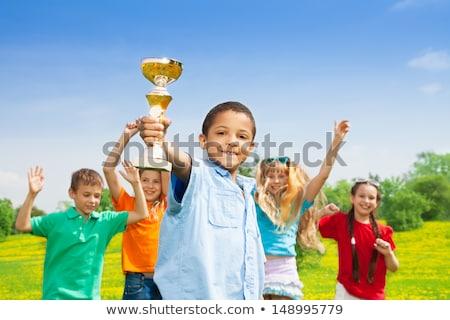 Gyerekek ünnepel sport siker szabadtér fiúk Stock fotó © matimix