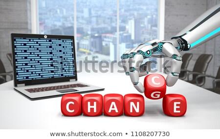 humanoide · robot · mano · cuaderno · manos · teclado - foto stock © limbi007