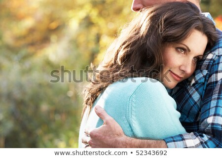 Close Up Of Romantic Couple Embracing By Autumn Woodland Stock photo © monkey_business