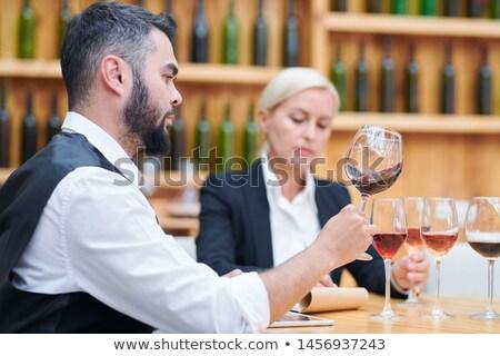 Contemporary cavist checking quality and characteristics of new sorts of wine Stock photo © pressmaster