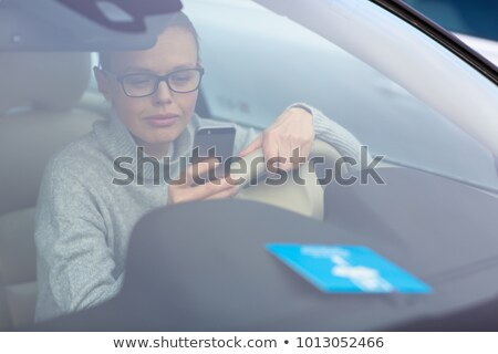 Nő szükséges parkolás óra mögött szélvédő Stock fotó © lightpoet