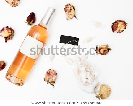 Flat lay. Minimal style. Minimalist trend photography. A bottle of rose with a composition of dried  Stock photo © serdechny