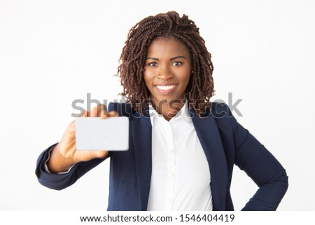 Smiling businesswoman holding blank white card in front of her m Stock photo © lichtmeister