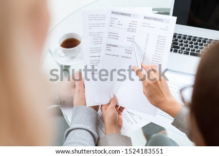 Hand of financial advisor with pen pointing at sum in document Stock photo © pressmaster