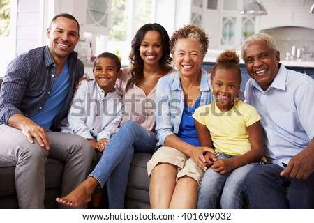 Front view of a happy African American multi-generation family reading a story book in living room a Stock photo © wavebreak_media