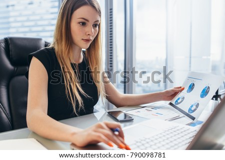 Financial analysts working with online data and papers by wooden table Stock photo © pressmaster