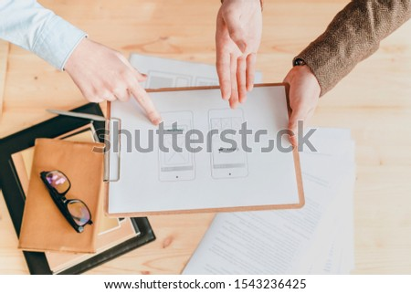 Overview of paper with program application being discussed by designers Stock photo © pressmaster