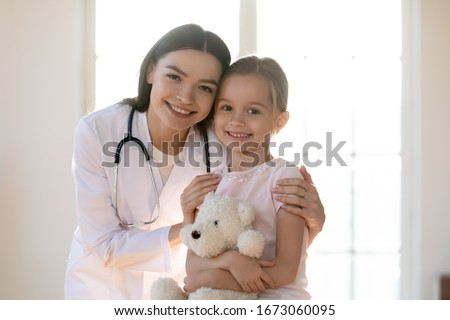 Successful clinician in uniform and medical equipment on head using touchpad Stock photo © pressmaster