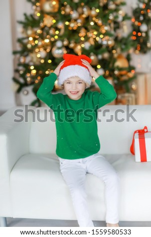 Barefooted boy in white pants on New Year's Eve is lying on the sofa Stock photo © ElenaBatkova