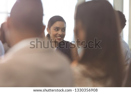 Rear view of mixed race  businesswoman interacting with her colleague during seminar in office build Stock photo © wavebreak_media