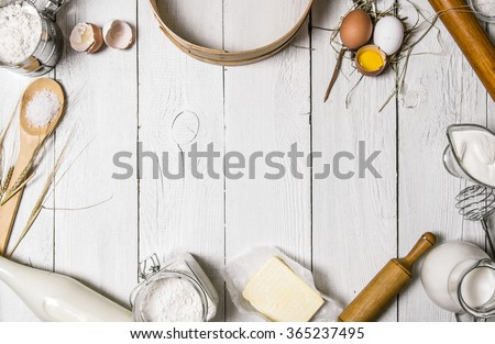 Top view of different dough recipe ingredients at kitchen table. Eggs, whisk, glass of milk and flou Stock photo © vkstudio