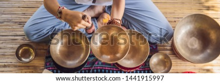 BANNER, LONG FORMAT Nepal Buddha copper singing bowl at spa salon. Young beautiful woman doing massa Stock photo © galitskaya