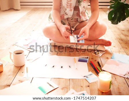 Young brunette woman creating her Feng Shui wish map using sciss Stock photo © dashapetrenko