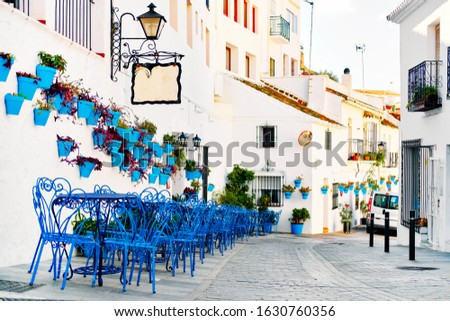Empty pedestrian footpath and hanging flower pots on residential Stock photo © amok