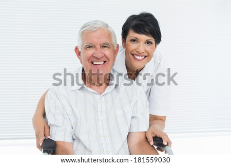 Front view of mature Caucasian female doctor and disabled Caucasian patient in wheelchair discussing Stock photo © wavebreak_media
