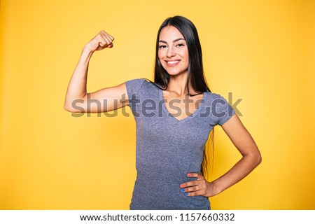 Close-up studio shot smiling, cheerful and strong young athlete male in casual t-shirt, cross arms c Stock photo © benzoix