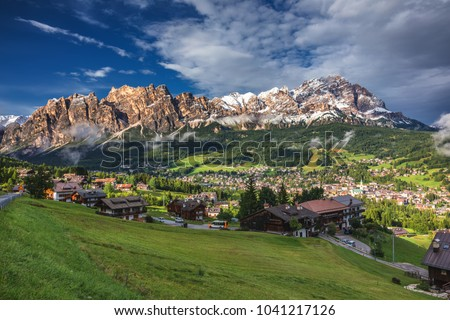 Town of Cortina d' Ampezzo in green landscape of Dolomites Alps Stock photo © xbrchx