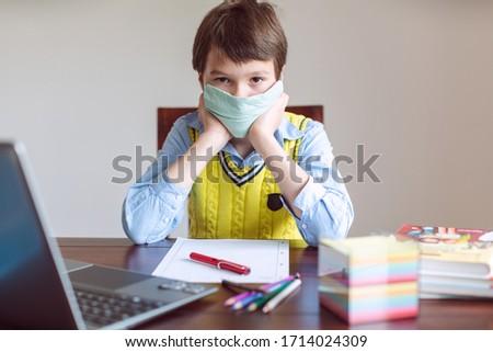 Pupil in despair because schools are still closed due to Coronavirus Stock photo © Kzenon