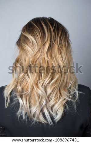 Ombre blond wavy hair. Beauty fashion blonde woman portrait. Bea Stock photo © Victoria_Andreas