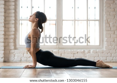 Woman practices yoga asana Urdhva Mukha Svanasana at the beach Stock photo © dmitry_rukhlenko