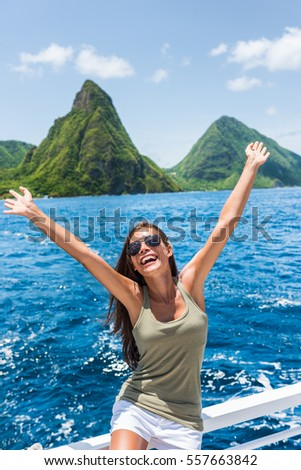 Happy freedom girl arms up having fun on excursion at Deux pitons, famous landmark of St Lucia. Worl Stock photo © Maridav