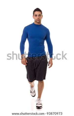 Stock photo: Athletic young man in a blue compression shirt. Studio shot over white.