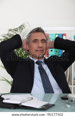 Portrait of an arrogant businessman with his hands behind his head Stock photo © photography33