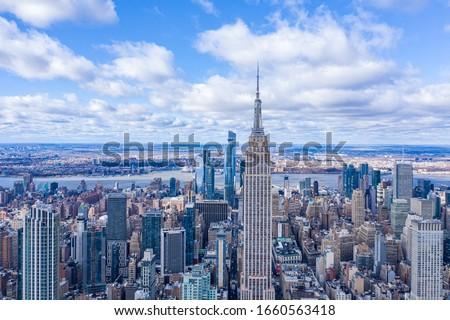 beautiful facade of modern skyscraper in New York in afternoon l Stock photo © meinzahn