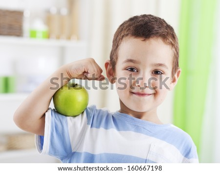 portrait of a male smiling doctor holding green apple on white stock photo © vlad_star