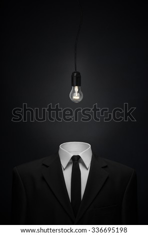 Businessman with burning lamp head on black background. Welcomin Stock photo © hasloo