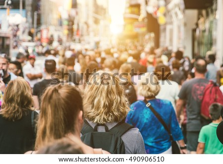 unrecognizable people walking in the street with sun backlight Stock photo © nito