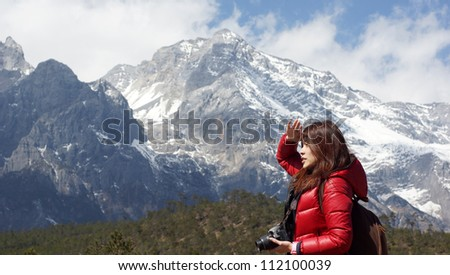 Chinese asian girl model under the snow mountain ridge background, fall into a trance, taking pictur Stock photo © lewistse