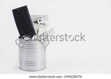 Businessman Filling Garbage Can With Obsolete Office Equipment Stock photo © HighwayStarz