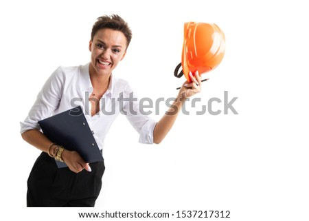 Beautiful girl in white helmet, shorts with shirt holding scrolls drawings and talking on walkie-tal Stock photo © cherezoff